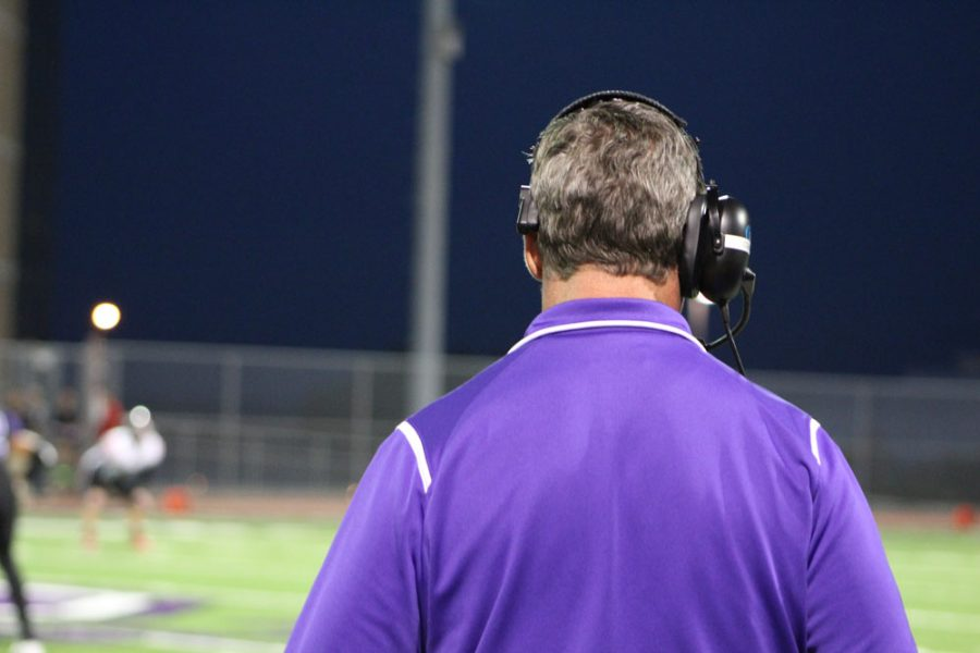 Head football coach Jay Ball focuses on an important play during the last home game.