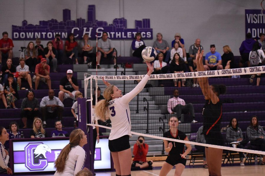 Senior focuses in volleyball and in-camera